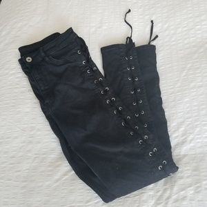 Black 3/4 skinny jeans with studded holes